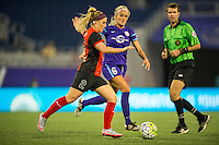 Orlando, Florida - Sunday, May 14, 2016: Western New York Flash midfielder Michaela Hahn (2) dribbles away from Orlando Pride midfielder Kaylyn Kyle (6) during a National Women's Soccer League match between Orlando Pride and New York Flash at Camping World Stadium.