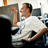 """WARSAW, POLAND, MAY 2011:.Consultant  during talk with client at the """"Call Center Poland"""" call center in Warsaw..(Photo by Piotr Malecki / Napo Images)..WARSZAWA, MAJ 2011:.Telemarketerzy w firmie """"Call Center Poland""""..Fot: Piotr Malecki / Napo Images.***Zdjecie moze byc wykorzystane w prasie, jesli sposob jego uzycia i podpis nie obrazaja osob znajdujacych sie na nim***"""