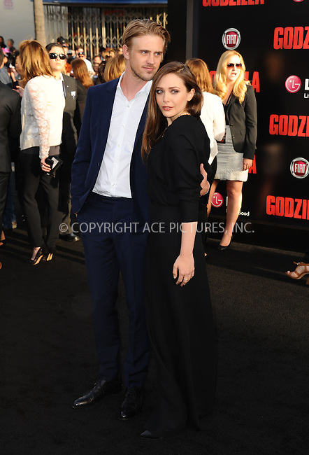ACEPIXS.COM<br /> <br /> May 8 2014, LA<br /> <br /> Boyd Holbrook and Elizabeth Olsen arriving at the Los Angeles premiere of 'Godzilla' at Dolby Theatre on May 8, 2014 in Hollywood, California. <br /> <br /> By Line: Peter West/ACE Pictures<br /> <br /> ACE Pictures, Inc.<br /> www.acepixs.com<br /> Email: info@acepixs.com<br /> Tel: 646 769 0430