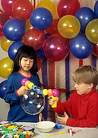 BH22-123x  Bubbles - children at birthday party with balloons and bubbles