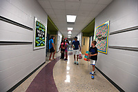 NWA Democrat-Gazette/J.T. WAMPLER  Students and parents walk down a hallway Wednesday August 7, 2019 after the ribbon cutting ceremony at Fairview Elementary School, the Rogers School DistrictÕs 16th elementary school.