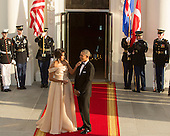 First Lady Michelle Obama touches the chin of United States President Barack Obama as they await the arrival of guests at the State Dinner while participating in the U.S.- Nordic Leaders Summit at The White House in Washington, DC, May 13, 2016.<br /> Credit: Chris Kleponis / CNP