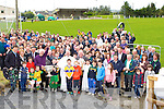 The large crowd at the opening of the new juvenile field at the Gneeveguilla GAA club on Sunday with the help of the Sam Maguire and Liam McCarthy Cups