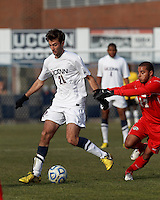 University of Connecticut midfielder Colin Bradley (20) looks to pass..NCAA Tournament. With a goal in the second overtime, University of Connecticut (white) defeated University of New Mexico (red), 2-1, at Morrone Stadium at University of Connecticut on November 25, 2012.