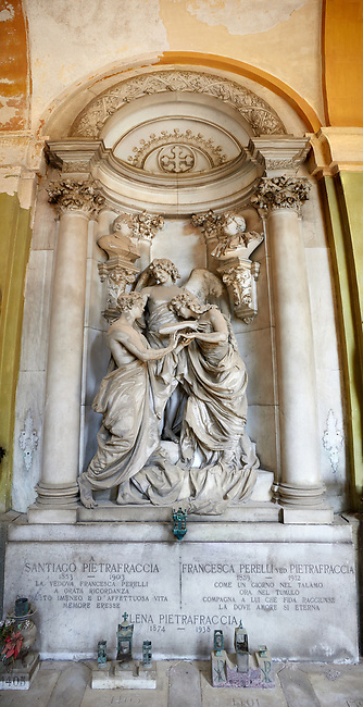 Picture and image  of the stone sculpture  of a young couple and an angel. The Pietrafraccia Tomb sculped by G. Navone 1909. Section A, no 17, The monumental tombs of the Staglieno Monumental Cemetery, Genoa, Italy