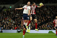 9th November 2019; Tottenham Hotspur Stadium, London, England; English Premier League Football, Tottenham Hotspur versus Sheffield United; Harry Kane of Tottenham Hotspur competes for the ball with Chris Basham of Sheffield United - Strictly Editorial Use Only. No use with unauthorized audio, video, data, fixture lists, club/league logos or 'live' services. Online in-match use limited to 120 images, no video emulation. No use in betting, games or single club/league/player publications