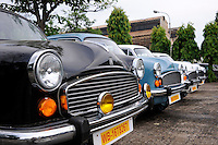 INDIA Kolkata Calcutta , HM Hind Motors car factory, here the Ambassador is still produced after license of Oxford Morris, new black and blue painted cars for the government , navy and army / INDIEN Kolkata Kalkutta , Fabrik HM Hind Motors, Herstellung von Ambassador , der HM Ambassador laeuft heute noch neu nach Vorlage des Oxford Morris bei HM Hindustan Motors vom Band