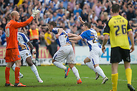 Lee Brown of Bristol Rovers (centre) celebrates his winning goal during the Sky Bet League 2 match between Bristol Rovers and Dagenham and Redbridge at the Memorial Stadium, Bristol, England on 7 May 2016. Photo by Mark  Hawkins / PRiME Media Images.