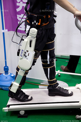 "A woman wears the ""Knee Assistive Instruments for Rehabilitation"" at the International Robot Exhibition 2013 in Tokyo, Japan, November 6, 2013. The IREX is the largest robot trade fair in the world and shows new robots and high technology equipments at theTokyo International Big Sight. The exhibitions runs from November 6 to 9. (Photo by Rodrigo Reyes Marin/AFLO)"
