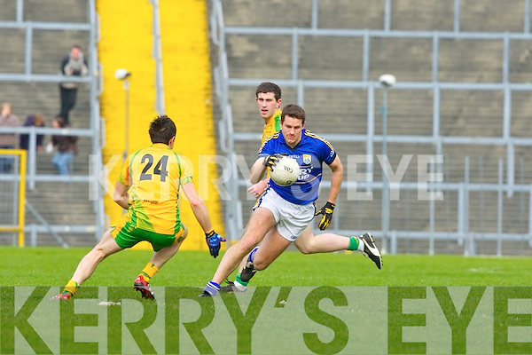 Eoin Brosnan goes past Donegal's David Walsh during their Allainz league clash in Fitzgerald Stadium on Sunday