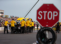 Aug 17, 2018; Brainerd, MN, USA; Crew members push the car of NHRA funny car driver J.R. Todd past a stop sign during qualifying for the Lucas Oil Nationals at Brainerd International Raceway. Mandatory Credit: Mark J. Rebilas-USA TODAY Sports