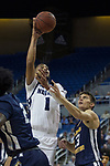 Nevada forward Robby Robinson (1) shoots over Colorado Christian forward Jadyn Michael during the second half of an NCAA college basketball game in Reno, Nev., Wednesday, Oct. 30, 2019.