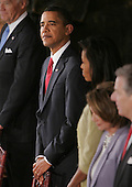 Washington, DC - January 20, 2009 -- United States President Barack Obama, center, and first lady Michelle Obama stand at the start of their lunch at Statuary Hall in the Capitol  in Washington, Tuesday, January 20, 2009. .Credit: Lawrence Jackson - Pool via CNP