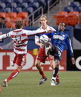 Colorado forward Jean Phillippe Peguero flicks a ball over the challenge of FC Dallas midfielder Simo Valakari. The Colorado Rapids drew 0-0 with FC Dallas in the first game of the Western Conference Semi-finals Invesco Field at Mile High, Denver, Colorado, September 22, 2005.