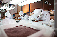 A picture dated April 18, 2013 shows workers doing quality control in a quinoa manufacturing plant, Jacha Inti in the city of El Alto in Bolivia.  2013  was declared the international year of Quinoa by the UN.  Bolivia is the main producer of quinoa in the world.
