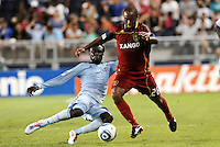 Kei Kamara (pale blue) Sporting KC tackles Collen Warner Real Salt Lake... Sporting Kansas City defeated Real Salt Lake 2-0 at LIVESTRONG Sporting Park, Kansas City, Kansas.