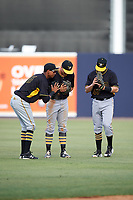 Bradenton Marauders left fielder Alfredo Reyes (13), center fielder Casey Hughston (17) and right fielder Kevin Krause (43) celebrate after the final out of the first game of a doubleheader against the Tampa Yankees on April 13, 2017 at George M. Steinbrenner Field in Tampa, Florida.  Bradenton defeated Tampa 4-1.  (Mike Janes/Four Seam Images)