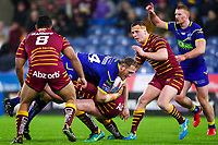 Picture by Alex Whitehead/SWpix.com - 08/02/2018 - Rugby League - Betfred Super League - Huddersfield Giants v Warrington Wolves - John Smith's Stadium, Huddersfield, England - Warrington's Ben Westwood is tackled by Huddersfield's Daniel Smith.