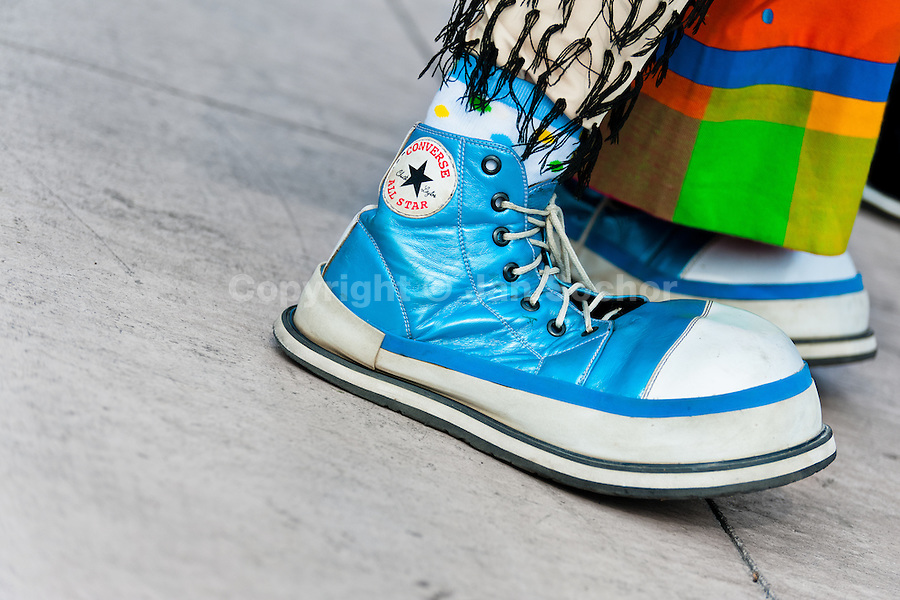 A clown wears oversized cyan Converse sneakers during the Clown Congress in San Salvador, El Salvador, 18 May 2011. The clown performance is considered a regular job in most of Latin American countries. Clowns may work individually or in groups, often performing advertisement like acts in large open-to-street shops or they take part in private shows, like children birthdays, family events etc. There are many clown conventions all over Latin America where clowns gather and exchange their experiences offering workshops of the comic acting or the art of make-up. For some of them, being clown is a serious lifetime profession.