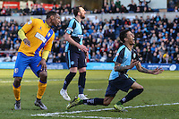Jerell Sellars of Wycombe Wanderers (right) shows his frustration at missing a chance to score during the Sky Bet League 2 match between Wycombe Wanderers and Mansfield Town at Adams Park, High Wycombe, England on 25 March 2016. Photo by David Horn.