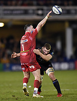 Rob Evans of the Scarlets offloads the ball after being tackled by Sam Underhill of Bath Rugby. European Rugby Champions Cup match, between Bath Rugby and the Scarlets on January 12, 2018 at the Recreation Ground in Bath, England. Photo by: Patrick Khachfe / Onside Images