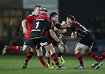 Scrum-half Cathal Sheridan of Munster Rugby is tackled by Fly half Dorian Jones and Loose-head prop Brok Harris of Newport Gwent Dragons.<br /> <br /> Guiness Pro 12<br /> Newport Gwent Dragons v Munster Rugby<br /> Rodney Parade<br /> 21.11.14<br /> ©Steve Pope-SPORTINGWALES