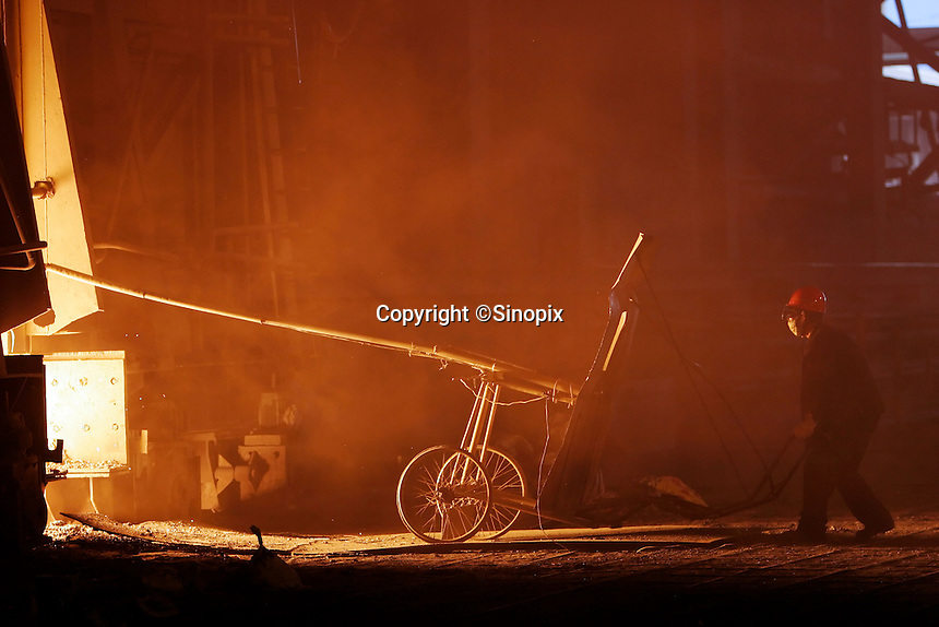 A worker uses a shielded cart to retrieve samples from a steel smelter at Ma Steel (Maanshan Iron & Steel Co.) in Maanshan, Anhui Province, China..10 Apr 2006