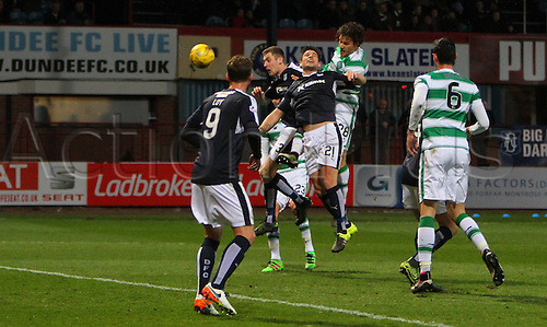05.04.2016. Dens Park, Dundee, Scotland. Scottish Football Premiership Dundee versus Celtic. Erik Sviatchenko wins the ball in the air
