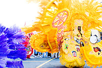 Wallace Pardo, chief of the Golden Comanches Mardi Gras Indians, dances in a circle in New Orleans on February 28, 2006.