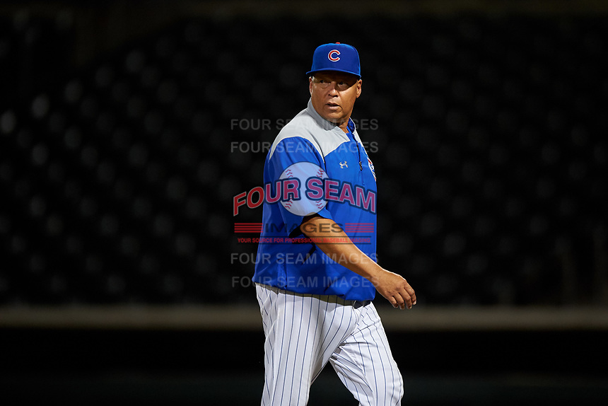 AZL Cubs 1 manager Carmelo Martinez walks to the dugout after visiting the mound during an Arizona League game against the AZL Padres 1 on July 5, 2019 at Sloan Park in Mesa, Arizona. The AZL Cubs 1 defeated the AZL Padres 1 9-3. (Zachary Lucy/Four Seam Images)