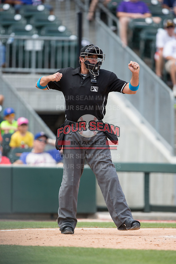 Home plate umpire Ryan Additon calls a batter out on strikes during the International League game between the Indianapolis Indians and the Charlotte Knights at BB&T BallPark on June 19, 2016 in Charlotte, North Carolina.  The Indians defeated the Knights 6-3.  (Brian Westerholt/Four Seam Images)