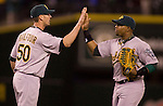 Oakland Athletics Yoenis Cespedes  high fives closer Grant Balfour (L) in a 4-0 win over the Seattle Mariners  at SAFECO Field in Seattle April 13, 2012.   © 2012. Jim Bryant Photo. All Rights Reserved.  .