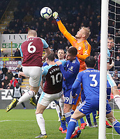 Leicester City's Kasper Schmeichel punches clear under pressure from Burnley's Ben Mee<br /> <br /> Photographer Rich Linley/CameraSport<br /> <br /> The Premier League - Burnley v Leicester City - Saturday 16th March 2019 - Turf Moor - Burnley<br /> <br /> World Copyright © 2019 CameraSport. All rights reserved. 43 Linden Ave. Countesthorpe. Leicester. England. LE8 5PG - Tel: +44 (0) 116 277 4147 - admin@camerasport.com - www.camerasport.com