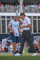 Ian Poulter (GBR) and his caddie celebrate after sinking his putt on 18 during round 4 of the Houston Open, Golf Club of Houston, Houston, Texas. 4/1/2018.<br /> Picture: Golffile | Ken Murray<br /> <br /> <br /> All photo usage must carry mandatory copyright credit (&copy; Golffile | Ken Murray)