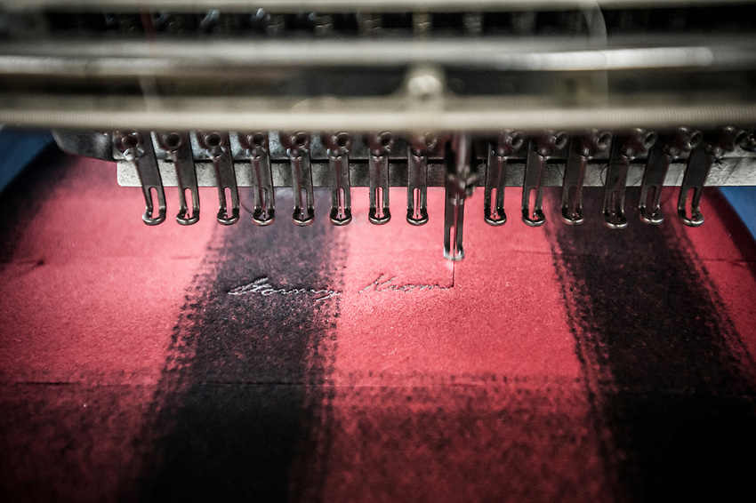 A step in the Stormy Kromer manufacturing process the automated embroidering of the logo at the Ironwood, Michigan production facility.