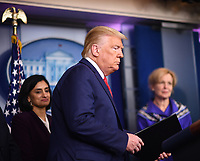 United States President Donald J. Trump arrives to deliver remarks on the COVID-19 (Coronavirus) pandemic alongside members of the Coronavirus Task Force in the Brady Press Briefing Room at the White House in Washington, DC on Wednesday, March 18, 2020.   At left is Seema Verma, Administrator, Centers for Medicare and Medicaid Services.<br /> Credit: Kevin Dietsch / Pool via CNP/AdMedia