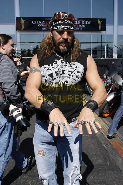 HOLLYWOOD WOLF YATES.Academy of Country Music Charity Motorcycle Ride for a Cause  held at MGM Grand, Las Vegas, Nevada, USA..May 17th, 2008.half length hat black vest sleeveless sunglasses shades top hands rings wrist bands beard facial hair .CAP/ADM/MJT.© MJT/AdMedia/Capital Pictures.