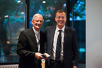 Sir James Dyson recieves his Provost's Circle medal from Paul Thompson