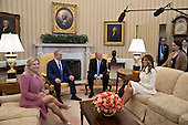 U.S. First Lady Melania Trump, from right, U.S. President Donald Trump, Benjamin Netanyahu, Israel's prime minister, and his wife Sara Netanyahu sit in the Oval Office of the White House in Washington, D.C., U.S., on Wednesday, Feb. 15, 2017. Netanyahu is trying to recalibrate ties with Israel's top ally after eight years of high-profile clashes with former President Barack Obama, in part over Israel's policies toward the Palestinians. <br /> Credit: Andrew Harrer / Pool via CNP
