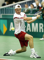 20040221, Rotterdam, ABNAMRO WTT, Hewitt in zijn partij tegen Henman