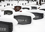 Snow clings to everything including to headstones at East Cemetery  in Manchester Conn., Friday, March 8, 2013, more than a foot of snow of heavy wet snow fell in the area making for very heavy lifting but visually pleasing winter scene. (AP Photo / Journal Inquirer, Jim Michaud).