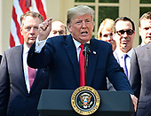 United States President Donald J. Trump answers reporter's questions following his remarks on the United States Mexico Canada Agreement (USMCA) in the Rose Garden of the White House in Washington, DC on Monday, October 1, 2018.  The President also took questions on the Kavanaugh nomination.  Visible behind the President are US Trade Representative Robert Lighthizer, left, and US Secretary of the Treasury Steven T. Mnunchin, right.<br /> Credit: Ron Sachs / CNP
