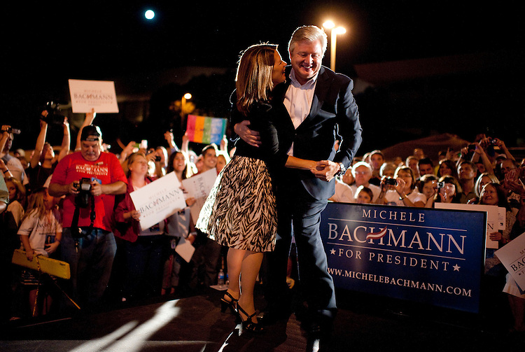UNITED STATES - AUGUST 12:  Rep. Michele Bachmann, R-Minn., dances with her husband Marcus Bachmann during a rally with supporters on the campus of Iowa State University in Ames, Iowa, the night before the Ames straw poll.  (Photo By Tom Williams/Roll Call)