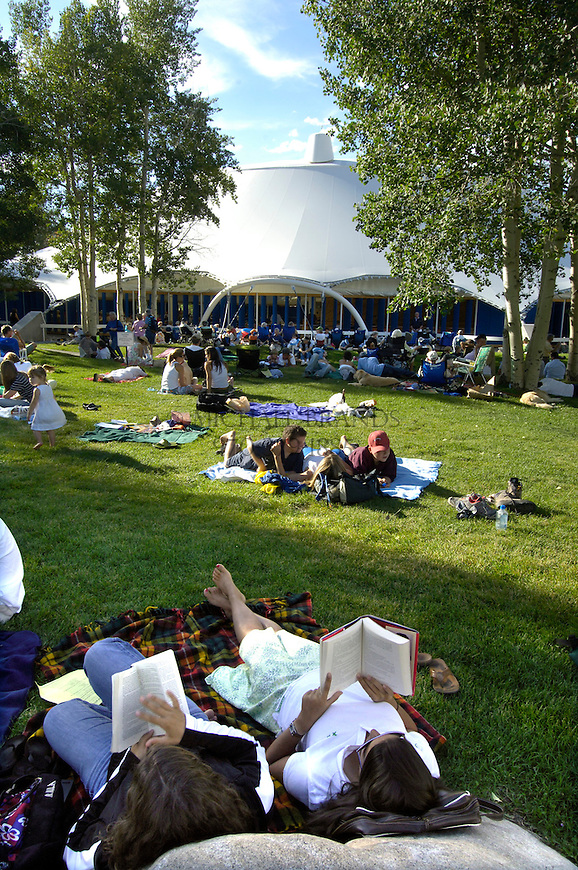 Listeners scatter the lawn outside the Benedict Music Tent, where listening is free, and find various ways to enjoy the music during Sunday's performance in Aspen, CO. Michael Brands for The New York Times.