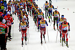 Martin Johnsrud Sundby (R) competes during the 15 Km Mass Start Classic race of Tour de ski as part of the FIS Cross Country Ski World Cup  in Val Di Fiemme, on January 9, 2016. Martin Johnsrud Sundby (NOR) wins and remains current leader.