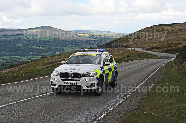 PRO team cyclists near the top of the challenging iconic and notorious 6km 10% stretch of road namely The Tumble during the Wales Velothon 2016 140km route cycling race.  Police control cars on the course. <br /> <br /> <br /> Jeff Thomas Photography -  www.jaypics.photoshelter.com - <br /> e-mail swansea1001@hotmail.co.uk -<br /> Mob: 07837 386244 -