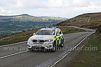 PRO team cyclists near the top of the challenging iconic and notorious 6km 10% stretch of road namely The Tumble during the Wales Velothon 2016 140km route cycling race.  Police control cars on the course. <br />