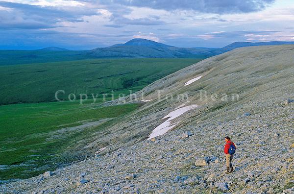 Hiker on Ingitkalik Mountain with Tiyaktalik Mountain in background at Cape Krusenstern National Monument, on shore of Chuckchi Sea, Alaska, AGPix_0710.