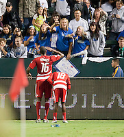 CARSON, CA – NOVEMBER 14: FC Dallas forward Atiba Harris (16) and midfielder Marvin Chavez (18) celebrate a goal during the Western Conference Final soccer match at the Home Depot Center, November 14, 2010 in Carson, California. Final score LA Galaxy 0, Dallas FC 3.