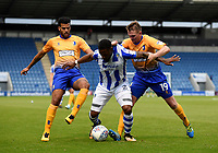 Colchester United's Ryan Jackson battles with Mansfield Town's Jacob Mellis and Johnny Hunt<br /> <br /> Photographer Hannah Fountain/CameraSport<br /> <br /> The EFL Sky Bet League Two - Colchester United v Mansfield Town - Saturday 7th October 2017 - Colchester Community Stadium - Colchester<br /> <br /> World Copyright &copy; 2017 CameraSport. All rights reserved. 43 Linden Ave. Countesthorpe. Leicester. England. LE8 5PG - Tel: +44 (0) 116 277 4147 - admin@camerasport.com - www.camerasport.com